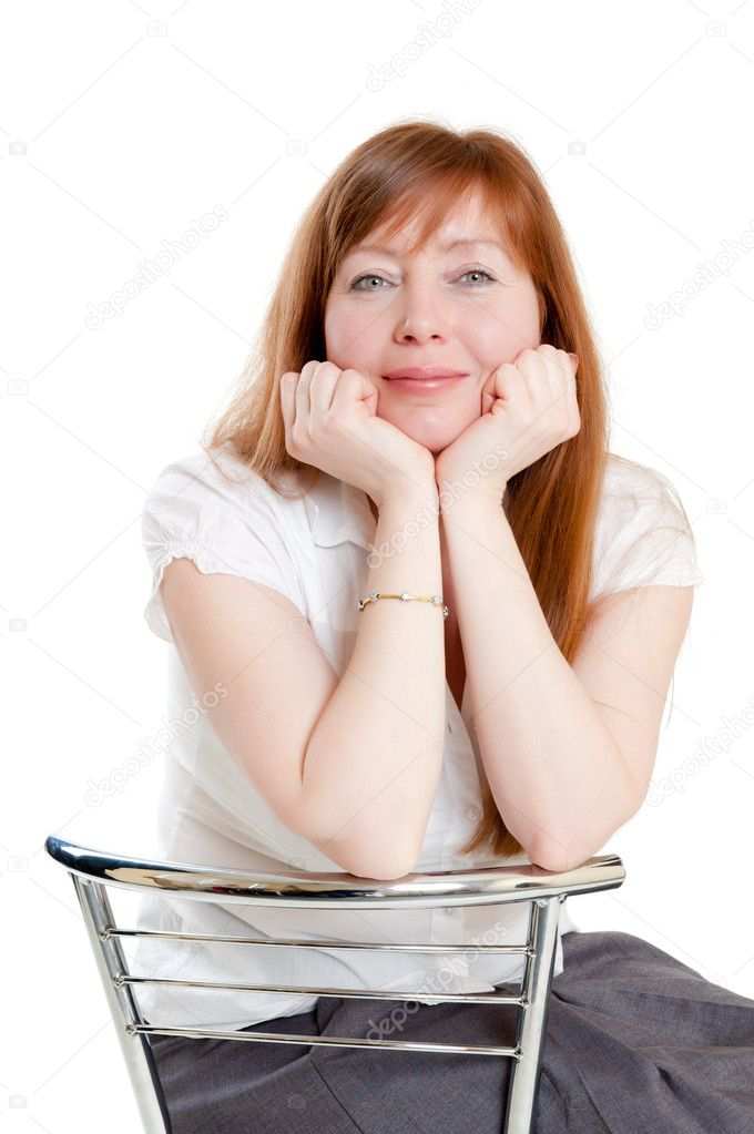 Red-haired woman sitting in a chair  Stock Photo #5587255