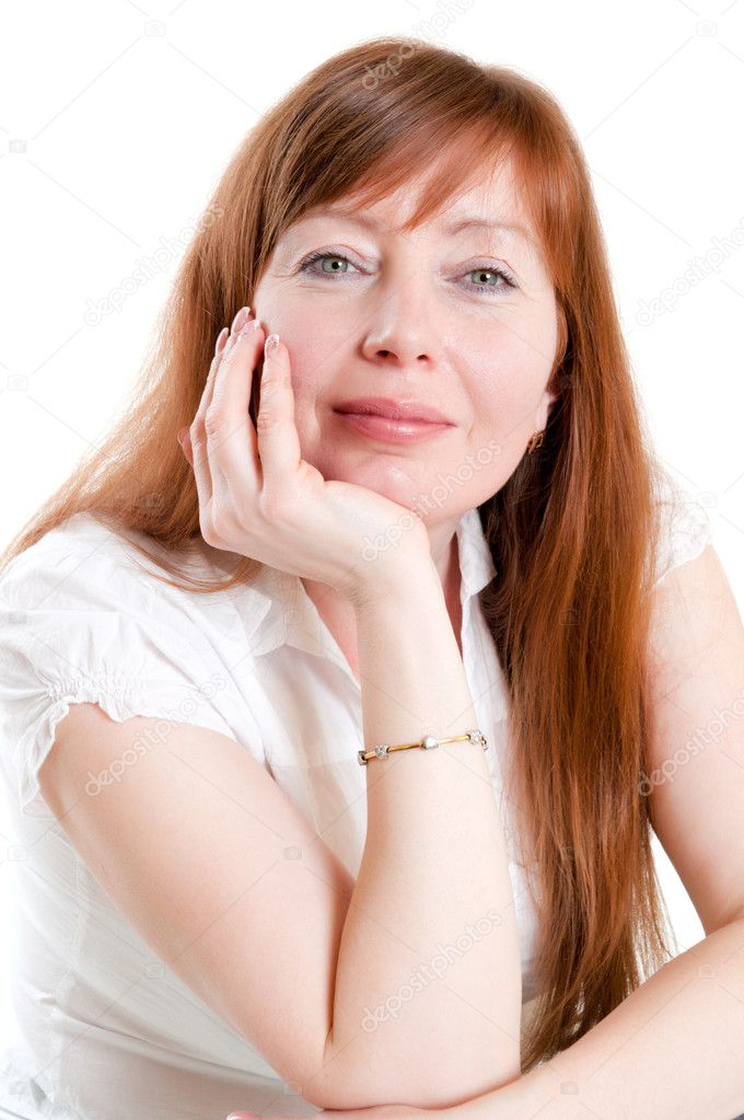 Portret of red-haired woman sitting in a chair — Stock Photo #5587358