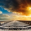 Railway to horizon under sunset — Stock Photo