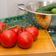 Stock Photo: Red tomato and green cucumbers