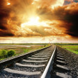 Railroad to sunset - Stock Photo
