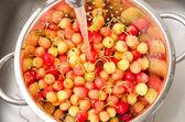 Fresh cherry in colander — Stock Photo
