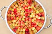 Fresh cherry in colander — Stock Photo