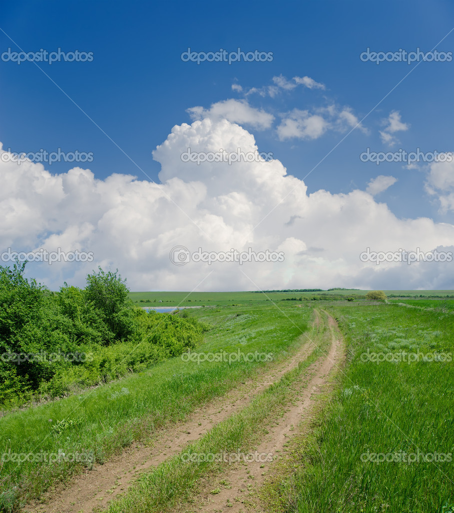 Rural road under clouds — Stock Photo #6132418