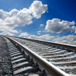 Railroad under deep blue sky - Stock Photo