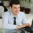 Handsome young men with laptop in public space. businessman  smi - Zdjęcie stockowe