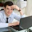 Handsome men think at the laptop — Stock Photo