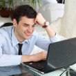 Royalty-Free Stock Photo: Smiling men think and work at the laptop