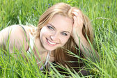 Young happy woman in green field — Stock Photo