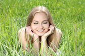 Enjoyment. Portrait of beautiful young girl on green field — Stock Photo
