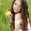 Happy smiling young woman present apples on the nature — Stock Photo