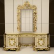 Baroque gold mirror with royal chest — Stock Photo #5555314