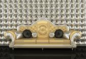 Sofá de couro dourado com uma moldura de prata sobre fundo prata — Fotografia Stock
