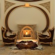 Armchairs near fireplace in modern interior. Warm — Stock Photo