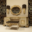Baroque table with mirror on the wallpaper background with ornament - Stock Photo