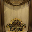 Royal armchair with curtain in luxury interior — Stock Photo #5702337