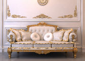 Luxurious leather sofa with pillows in Royal interior — Stock Photo