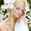 Stock Photo: Portrait of Beautiful romantic womwith flower. sensual to