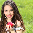 beautiful young woman with red lips and long hair present red ap — Stock Photo #5731081