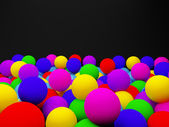 Color balls on the black background — Stock Photo