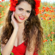 Stock Photo: Girl with beautiful smile and haircut. In red dress on the natur