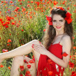 Beautiful young woman with long legs on the nature. Poppy field. — Stock Photo