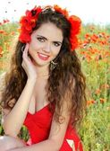 Girl with beautiful smile and haircut. In red dress on the natur — Stock Photo