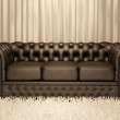 Brown leather Chester sofa in luxury interior — Stock Photo
