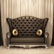 Luxurious leather sofa with pillows on the curtain background. — Stock Photo #5855097