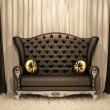 Luxurious leather sofa with pillows on the curtain background. — Stock Photo