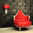 Armchair with lamp in interior with pattern wallpaper — Stock Photo