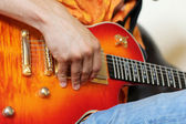Hands on guitar. Really great shot capturing detail of a guitari — Stock Photo