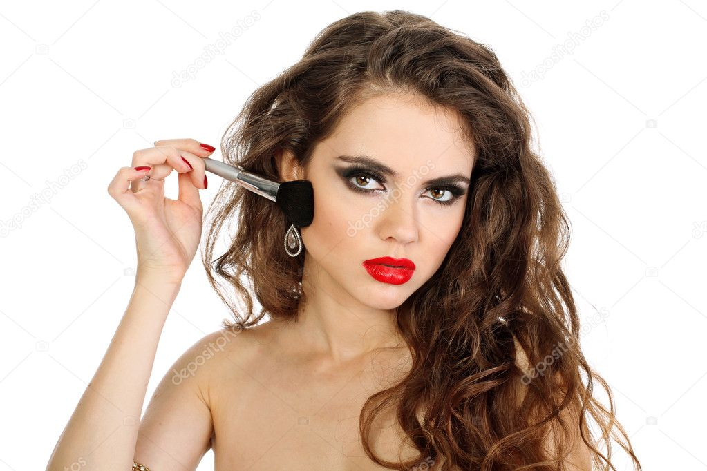 Hairstyle. Beautiful Young Woman With A Make-up Brush