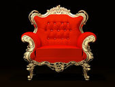 Royal armchair with gold frame isolated on black background — Stock Photo