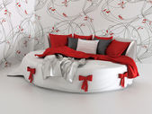 Gift bed in modern interior with wallpapers — Stock Photo
