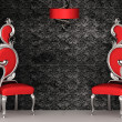 Two red chairs with royal back isolated on ornament wallpapers - Stockfoto