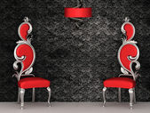Two red chairs with royal back isolated on ornament wallpapers — Stok fotoğraf