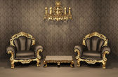 Armchairs with gold frame in old interior. Luxurious furniture. — Stock fotografie