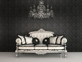 Royal sofa with pillows and chandelier in luxurious interior wit — Stock Photo