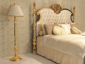 Luxurious bed with golden frame and stand lamp in royal bedroom — Stock Photo