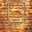 Empty golden frame on brick wall - Stock Photo