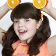 Smiling little girl with orange, happiness — Stockfoto