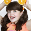 Smiling little girl with orange, happiness — Foto Stock