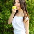 Beautyful woman present apples.Go to you on the Nature — Stock Photo #6649673