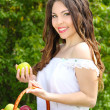 Beautyful woman present apples.Go to you on the Nature — Stock Photo #6649679
