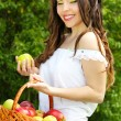 Beautyful woman present apples.Go to you on the Nature — Stock Photo #6649683