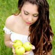 Beautyful woman present apples.Go to you on the Nature — Stock Photo #6649689