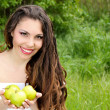 Beautyful woman present apples.Go to you on the Nature — Stock Photo #6649702