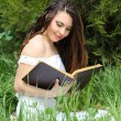 Young beautiful girl reading a book outdoor — Stock Photo #6649754