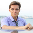 Portrait of handsome young businessman, outdoors — Stock Photo